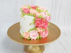 Ruffly buttercream flowers and gold leaf